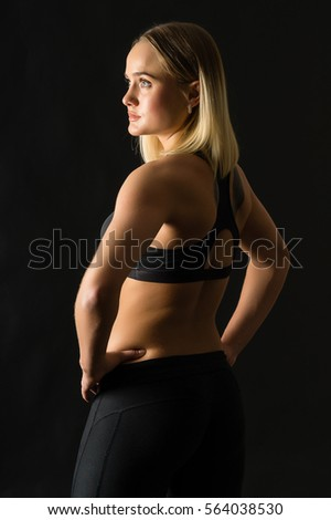 Woman Boxer On A Black Background Sport Girl With Big Booty Looks Back