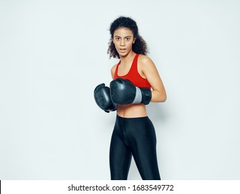 Woman in boxing gloves kick workout motivation