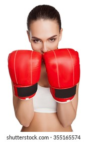 Woman in boxing gloves and sportswear on a white background