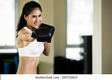 Woman with boxing gym
