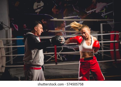 Woman boxing  with her trainer