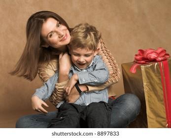 Woman and boy checking christmas presents