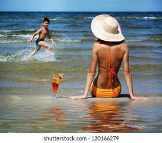 Woman and boy on the beach