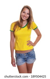 Woman in brazilian shirt laughing at camera