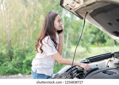 woman with BREAKDOWN car