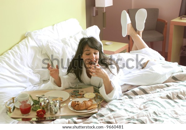 a woman with a breakfast on the bed