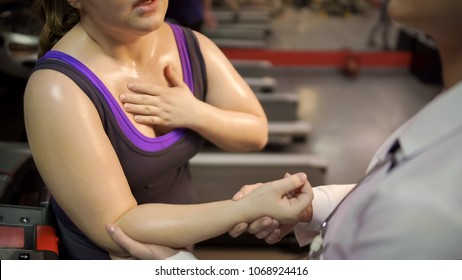 Woman breathing heavily, suffering tachycardia, doctor taking her pulse rate