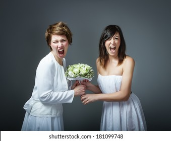 woman in bride dress fighting
