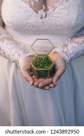 woman bride holding a box of wedding rings