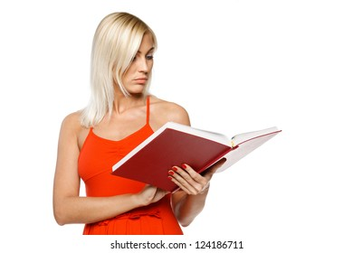 Woman in bright red dress reading a book over white background