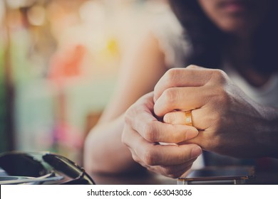 woman broken heart  and feeling sad with ring