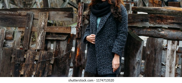 61805e99a9 woman brown-haired woman in a gray coat