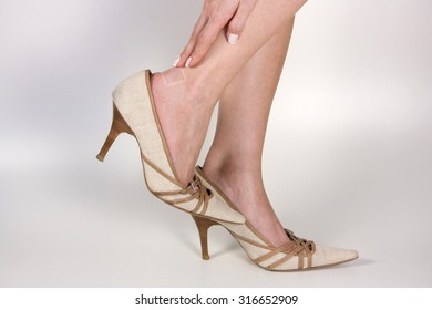 Woman with bruised heel because tight Shoe