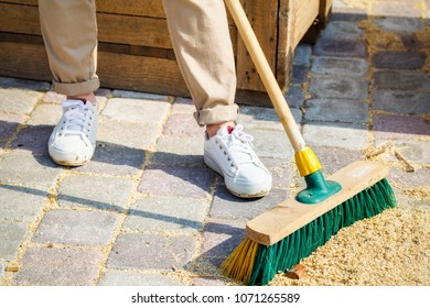 Woman with brush clean up yard