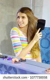 Woman brush long silky beautiful healthy hair