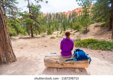 Woman in Bryce Canyon looking and enjoying view during her hike. Bryce Canyon National Park landscape, Utah, United States.