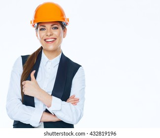 Woman builder in business suit show thumb up. White background.