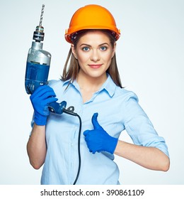 Woman builder hold drill, show thumb up. Isolated studio portrait.