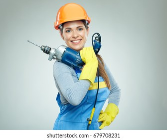 Woman builder holding drill tool. Isolated portrait.