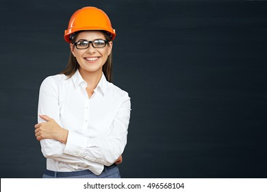 Woman builder isolated portrait with protect helmet. Black background.