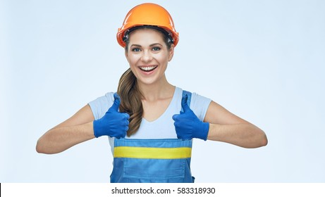 Woman builder wearing coverall and protect helmet show thumbs up. Smiling woman hard worker isolated portrait.