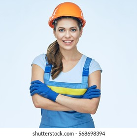 Woman builder worker standing with crossed arms. isolated portrait smiling woman.