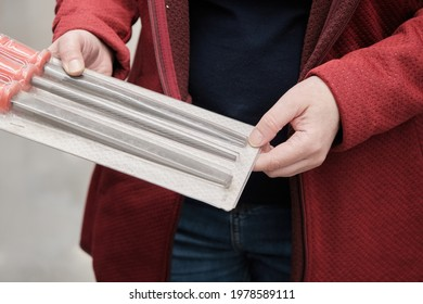 Woman in a building materials store buys nadfils and rasps of different shapes. Hands close up shot. Concept of women independence, feminism, gender equality, repair and construction