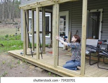 woman building screened porch