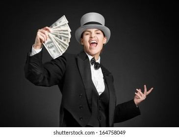 Woman with a bundle money in his hand. Gangster girl keeps money in hands