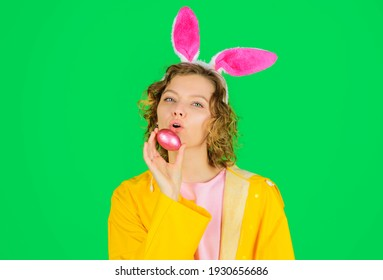 Woman with bunny ears with Easter egg. Rabbit girl. Happy Easter. Spring time. Eggs hunt. Spring holidays.