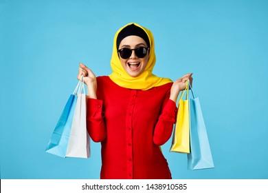 woman in burqa shopping shopping store