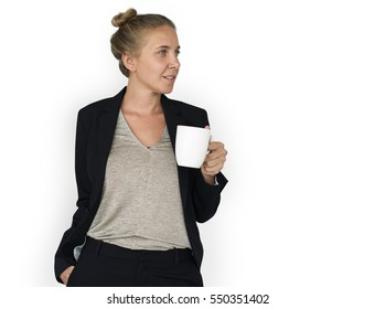 Woman in business attire drinking from a mug
