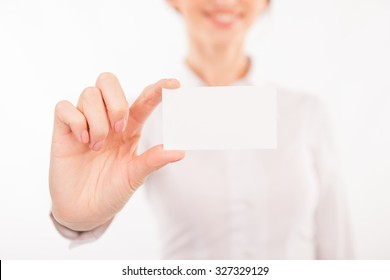Woman with business card. Beautiful young woman in formalwear stretching out her business card