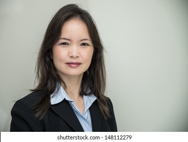Woman in business suit, with grey background