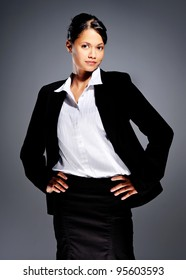 Woman in business suit with hands on hips