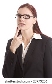 Woman in business suit with her finger on her chin thinking it over