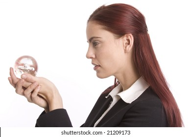 Woman in business suit holding crystal ball in her hands