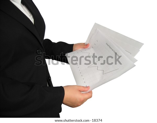 A woman in business suit holds a chart in her hand.