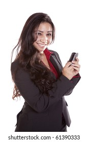 A woman in a business suit sending a text message.