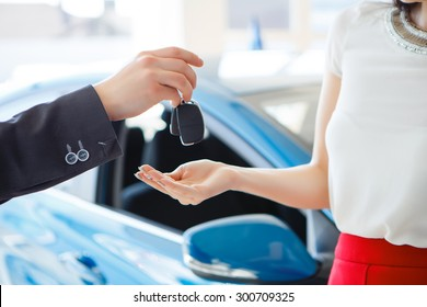 woman buying a car, sale