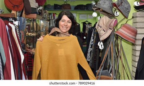 Woman buying clothes in a bazaar
