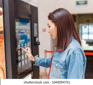 woman buying coffee from automatic vending machine