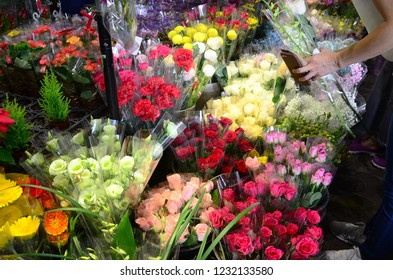 Woman buying flowers at the market