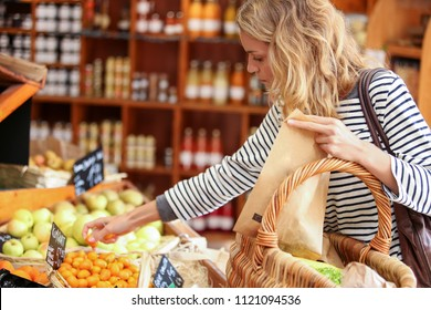 woman buying fruits and vegetables, healthy food in small superm