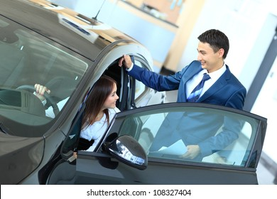 Woman buying a new car