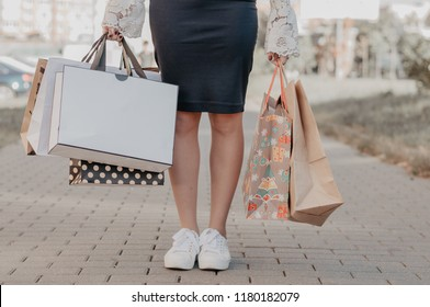Woman buying on the black friday sale. Holding packages