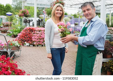 Woman buying a plant at the garden center