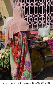 Woman buying vegetables in the market of  Jaipur, Rajasthan, India