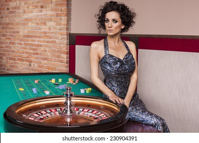 WOman by roulette table at casino