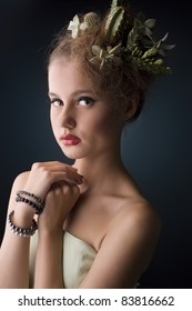 Woman with cactus in her hair on a black background